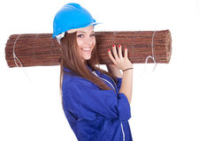 Woman in hardhat and overalls with wicker mat Royalty Free Stock Photo