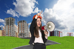 Woman in hardhat screaming in megaphone Royalty Free Stock Image