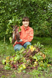 Woman with harvested beetroot Stock Photos