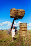Woman in the harvested  wheat field Royalty Free Stock Photo