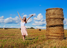 Woman in the harvested  wheat field Royalty Free Stock Images