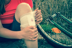 Woman has accident injury from bicycle - retro style Royalty Free Stock Images