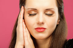 Woman has blindly put hands in head Royalty Free Stock Images