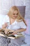 Woman has breakfast in bed Stock Photo