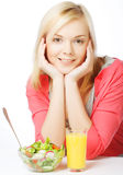 Woman has breakfast salad from fresh vegetables Royalty Free Stock Photography