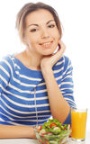 Woman has breakfast salad from fresh vegetables Stock Images