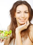 woman has breakfast salad from fresh vegetables Stock Photos