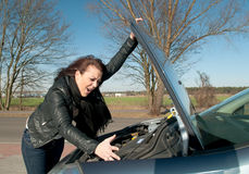 Woman has a car breakdown Stock Photo