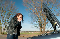Woman has a car breakdown Royalty Free Stock Photos