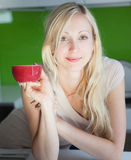 Woman has coffee break at home Royalty Free Stock Photography