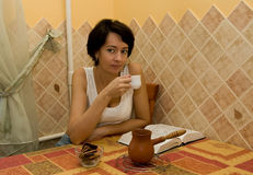 Woman Has Coffee On Kitchen Stock Images