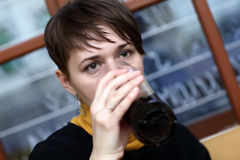 Woman has dark beer Stock Photo