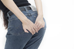 Woman has diarrhea holding her bum. Pain in the butt, isolated on white background Stock Photo