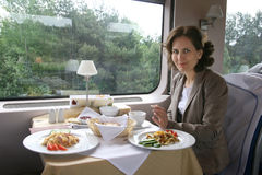 The woman has dinner in train Stock Photos