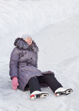 Woman has fallen on the rink Royalty Free Stock Images