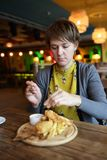 Woman has fillet of cod Royalty Free Stock Image
