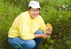 The woman has found a mushroom. In wood, rejoices stock photos