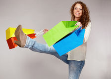Woman has fun on spending spree.  Stock Images