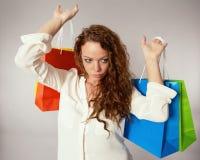 Woman has fun on spending spree Stock Photo
