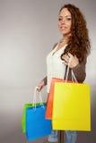 Woman has fun on spending spree.  Stock Photo