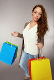 Woman has fun on spending spree.  Royalty Free Stock Images