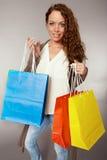 Woman has fun on spending spree.  Royalty Free Stock Photo