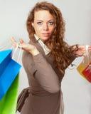 Woman has fun on spending spree.  Royalty Free Stock Image
