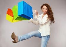 Woman has fun on spending spree Stock Image