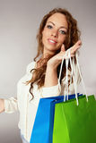 Woman has fun on spending spree.  Royalty Free Stock Photos