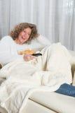 Woman has fun zapping Royalty Free Stock Photos