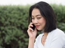 Woman has a good happy mobile phone conversation. royalty free stock photography