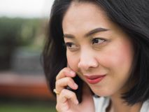 Woman has a good happy mobile phone conversation. stock image