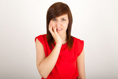 The woman has got toothache and is holding her cheek Royalty Free Stock Image