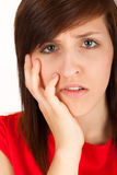 The woman has got toothache and is holding her cheek Stock Photo