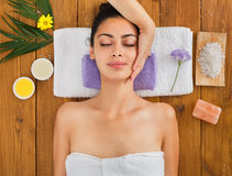 Woman has head massage in indian spa wellness center. Head massage in aroma spa. Young woman in wellness center. Professional cosmetologist make procedure to Royalty Free Stock Photography