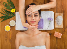 Woman has head massage in indian spa wellness center. Head massage in spa. Young woman in wellness center. Professional cosmetologist make procedure to beautiful Royalty Free Stock Image