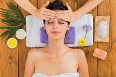 Woman has head massage in indian spa wellness center. Head massage in spa. Young woman in wellness center. Professional cosmetologist make procedure to beautiful Royalty Free Stock Photos