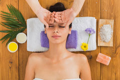 Woman has head massage in indian spa wellness center. Head massage in spa. Young woman in wellness center. Professional cosmetologist make procedure to beautiful Stock Photography