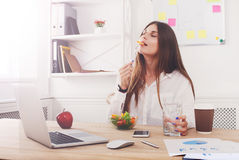 Woman has healthy business lunch in modern office interior Royalty Free Stock Images