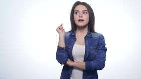The woman has an idea. Attractive young woman showing gesture that she came up with a great idea