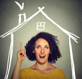 Woman has an idea looking up house roof above head Stock Photography