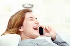 Woman has a joyful talk over telephone Stock Image