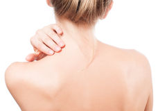 Woman has neck pain. Nude shoulders girl from the back. Stock Photography