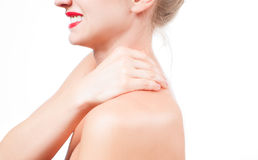 Woman has neck pain. Nude shoulders girl from the back. Royalty Free Stock Photos