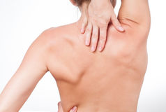 Woman has neck pain. Nude shoulders girl from the back. Royalty Free Stock Photo