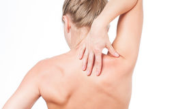 Woman has neck pain. Nude shoulders girl from the back. Stock Photo
