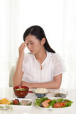 Woman has no appetite Royalty Free Stock Photos