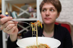 Woman has noodles Royalty Free Stock Images