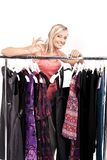 Woman has a plenty of clothes to choose from Stock Image