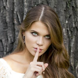 Woman Has Put Forefinger To Lips As Sign Of Silence Stock Photography